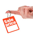 Hand holding price tag Royalty Free Stock Photos