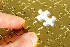 Hand holding a puzzle Royalty Free Stock Images