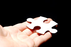 Hand holding a puzzle piece Royalty Free Stock Photography