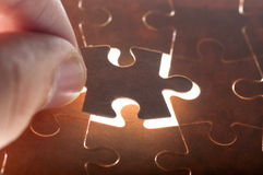 Hand holding puzzle piece close up Royalty Free Stock Photo
