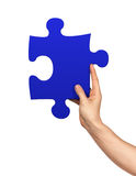 Hand holding puzzle piece Stock Photography