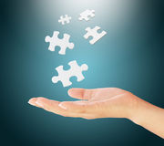 Hand holding a puzzle pieces. Royalty Free Stock Photography