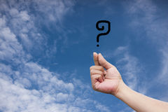 Hand holding a question mark Royalty Free Stock Images
