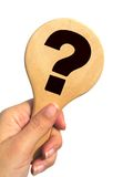 Hand holding question mark signpost - isolated Royalty Free Stock Images