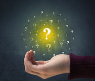 Hand holding question marks Royalty Free Stock Photos