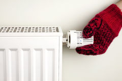Hand holding radiator thermostat Royalty Free Stock Photos