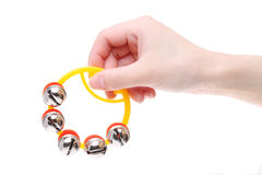Hand holding rattle jingle bell Stock Photos
