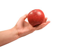 Hand holding red an apple on white background Stock Photos