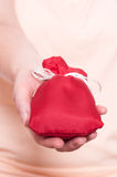 Hand is holding a red bag Stock Photo