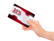 Hand holding red discount card isolated over white Royalty Free Stock Images