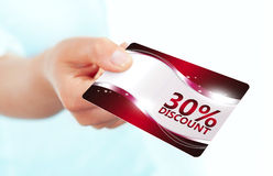 Hand holding red discount card isolated over white Stock Photo