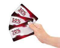 Hand holding red discount cards isolated over white Stock Image