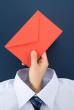 Hand holding an red envelope Stock Photography