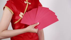 Hand holding envelope in concept of happy chinese new year. Hand holding red envelope in concept of happy chinese new year