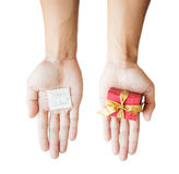 Hand holding red gift box, and paper note, isolated on white background Royalty Free Stock Photo