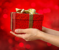 Hand holding red gift box Stock Photo