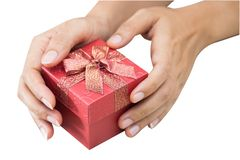Hand holding red gift box. stock photo