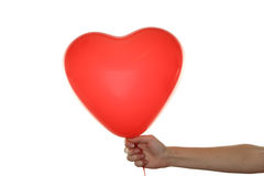 Hand holding a red heart balloon isolated on a white Stock Photos