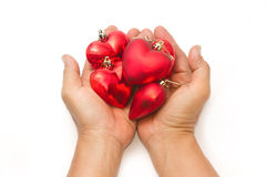 Hand holding red heart Stock Photos