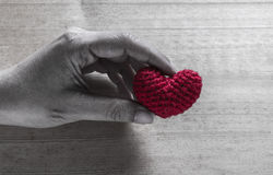 Hand Holding Red Heart Shaped Silk Royalty Free Stock Photography