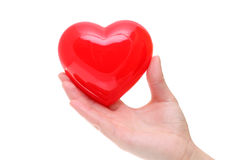 Hand holding red heart symbol Stock Photo