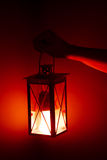 Hand holding red lamp Stock Photography