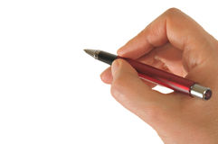 Hand holding a red pen Royalty Free Stock Images