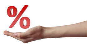 Hand holding red percent sign. sale concept Stock Photos