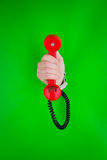 Hand holding red phone Royalty Free Stock Image