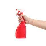 Hand holding red plastic spray bottle. Royalty Free Stock Images