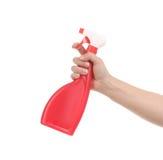 Hand holding red plastic spray bottle Stock Photo