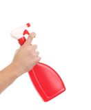 Hand holding red plastic spray bottle. Stock Image
