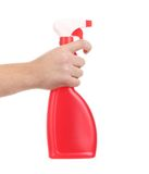 Hand holding red plastic spray bottle. Royalty Free Stock Photo