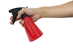 Hand holding red plastic spray bottle. Royalty Free Stock Photography