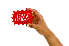 Hand holding a red sale sign Royalty Free Stock Photo