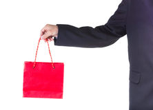 Hand holding red shopping bag. Stock Photos