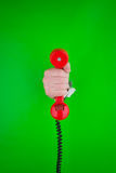 Hand holding red telephone Stock Photos