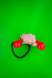 Hand holding red telephone Stock Photo