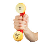 Hand holding red telephone receiver Royalty Free Stock Image