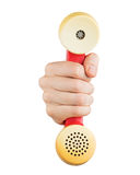 Hand holding red telephone receiver Stock Photos