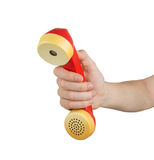 Hand holding red telephone receiver Stock Image