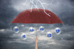 Hand holding red umbrella. insurance policy Life health Stock Images