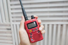 A hand holding red Walkie-Talkie Stock Photos