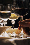 Hand holding red wine in stem glass Stock Image