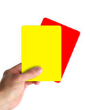 Hand holding red and yellow cards. Isolated on white royalty free stock photos