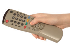 Hand holding a remote Stock Images