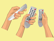 Hand holding remote. The hand holding a remote Royalty Free Stock Images