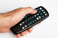 Hand holding remote Stock Photography