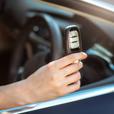 Hand holding remote car key Royalty Free Stock Photo