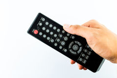 Hand holding remote console Stock Images